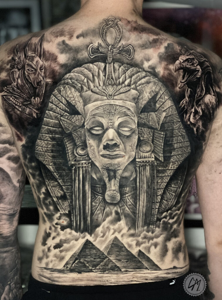 Finished back piece part healed part fresh. Tattoos by Craig Mackay.